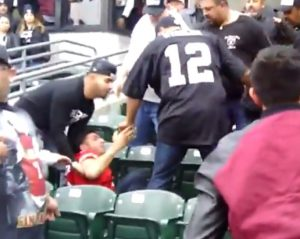 Raiders and Niners fans fight in the stands [Video]